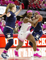 North Carolina State's DD Rogers, middle, drives between Notre Dame's Abby Prohaska, left, and Notre Dame's Arike Ogunbowale, right, during the first half of an NCAA college basketball game in Raleigh, N.C., Monday, Feb. 18, 2019. (AP Photo/Ben McKeown)