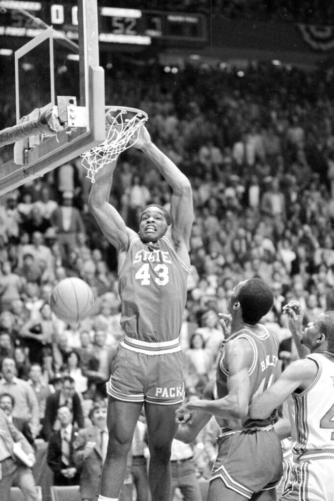 FILE - In this April 4, 1983, file photo, North Carolina State's Lorenzo Charles (43) dunks the ball in the basket to give N.C. State a 54-52 win over Houston in the NCAA Final Four Championship game in Albuquerque, N.M. (AP Photo/File)