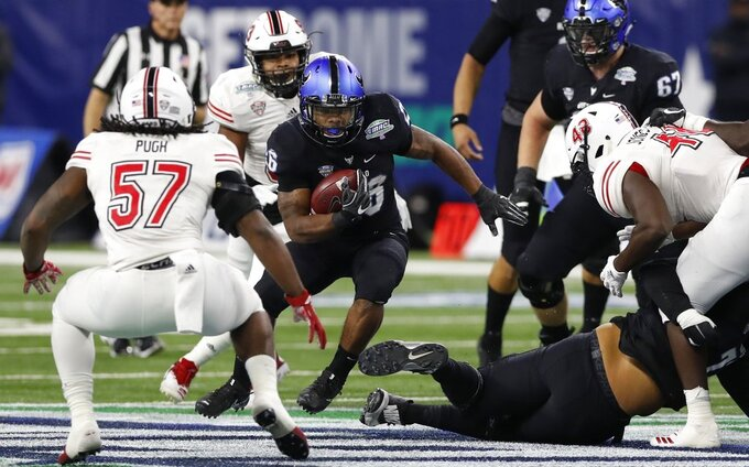 Buffalo running back Jaret Patterson (26) rushes against the Northern Illinois defense during the first half of the Mid-American Conference championship NCAA college football game, Friday, Nov. 30, 2018, in Detroit. (AP Photo/Carlos Osorio)