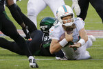 Miami Dolphins quarterback Ryan Fitzpatrick (14) is tackled by New York Jets defensive end Nathan Shepherd (97) during the fourth quarter of an NFL football game, Sunday, Dec. 8, 2019, in East Rutherford, N.J. (AP Photo/Seth Wenig)