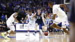 Xavier's Jason Carter (25) dribbles down the court against Seton Hall's Shavar Reynolds, center left, during the first half of an NCAA college basketball game, Saturday, feb. 1, 2020, in Newark, N.J. (AP Photo/Michael Owens)