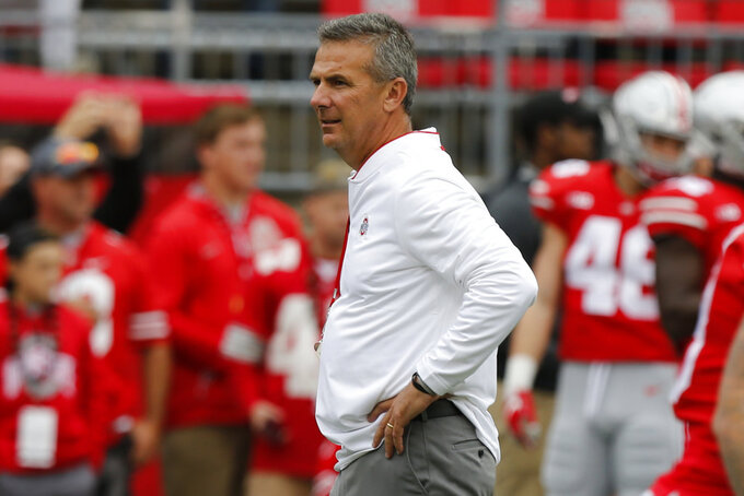 FILE - In this Sept. 22, 2018, file photo, Ohio State head coach Urban Meyer watches his team play against Tulane during an NCAA college football game in Columbus, Ohio. The Bukeyes are No. 2 nationally in total offense, No. 6 in scoring offense, No. 25 in scoring defense, tied for No. 13 in turnover margin share the East Division lead with No. 6 Michigan. (AP Photo/Jay LaPrete, FIle)