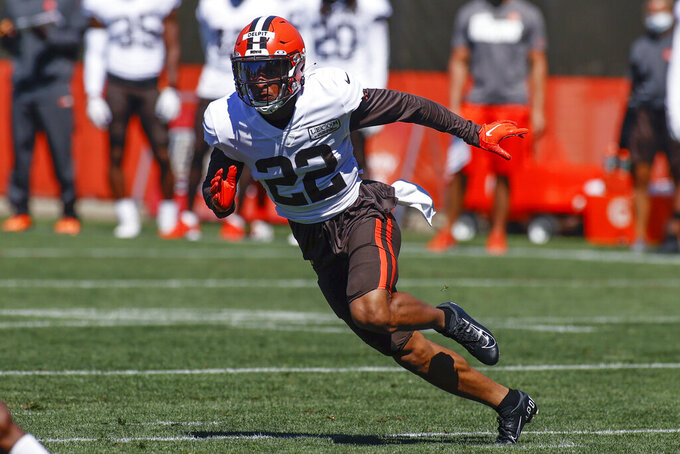 FILE - In this Wednesday, Aug. 19, 2020 file photo, Cleveland Browns safety Grant Delpit runs through a drill during practice at the NFL football team's training facility in Berea, Ohio.Grant Delpit had mixed emotions during the Cleveland Browns' breakthrough 2020 season. The rookie safety from Louisiana State was under contract, but didn't necessarily feel like he was part of the team after rupturing his right Achilles during training camp.  (AP Photo/Ron Schwane, File)