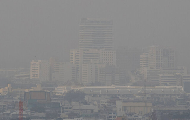A thick layer of smog covers central Bangkok, Thailand, Monday, Jan. 20, 2020. Thick haze blanketed the Thai capital on Monday sending air pollution levels soaring to 89 micrograms per cubic meter of PM2.5 particles in some areas, according to the Pollution Control Department. (AP Photo/Sakchai Lalit)