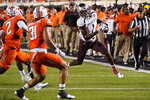 Missouri State wide receiver Xavier Lane runs around Oklahoma State safety Tanner McCalister (2) and safety Kolby Harvell-Peel (31) during the second half of an NCAA college football game Saturday, Sept. 4, 2021, in Stillwater, Okla. (AP Photo/Sue Ogrocki)