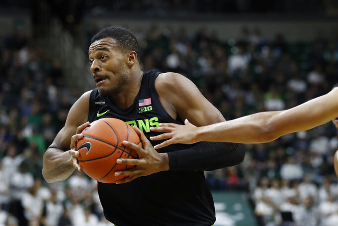 Michigan State forward Xavier Tillman goes to the basket during the second half of an NCAA college basketball game against Charleston Southern, Monday, Nov. 18, 2019, in East Lansing, Mich. (AP Photo/Carlos Osorio)