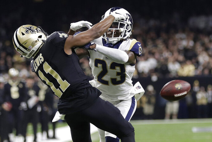 "FILE - In this Jan. 20, 2019, file photo, Los Angeles Rams' Nickell Robey-Coleman breaks up a pass intended for New Orleans Saints' Tommylee Lewis during the second half of the NFL football NFC championship game in New Orleans.  They were badly burned by the ""Nola no-call,"" but the New Orleans Saints have joined the NFL in opposing a fan's lawsuit seeking damages over the missed penalty that helped the Los Angeles Rams beat the Saints in a January playoff game and move on to the Super Bowl.  (AP Photo/Gerald Herbert, File)"