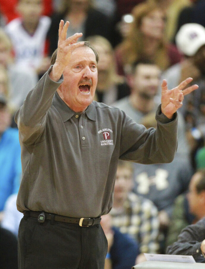 FILE - In this Feb. 3, 2015, file photo, Philadelphia University's Herb Magee gestures during the team's game against Wilmington in Philadelphia. Magee joined Duke coach Mike Krzyzewski as the only NCAA men's coaches to win 1,100 basketball games. Krzyzewski has 1,138 wins (1,065 with Duke) in a career that started with Army in 1975. Magee hit the magic number this week when Jefferson University (the new name for Philadelphia University) beat Kutztown 98-79 in front of maybe 1,000 fans at home on Henry Avenue. (Charles Fox/The Philadelphia Inquirer via AP, File)