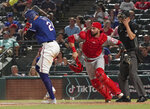 Los Angeles Angels catcher Anthony Bemboom scrambles after a wild pitch to Texas Rangers Hunter Pence, allowing Elvis Andrus to advance during the ninth inning of a baseball game Wednesday, Aug. 21, 2019, in Arlington, Texas. The Rangers won 8-7. (AP Photo/Louis DeLuca)