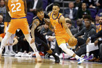 Orlando Magic's Markelle Fultz (20) tries to stay with Phoenix Suns' Elie Okobo (2) who dribbles around a pick during the first half of an NBA basketball game Friday, Jan. 10, 2020, in Phoenix. (AP Photo/Darryl Webb)