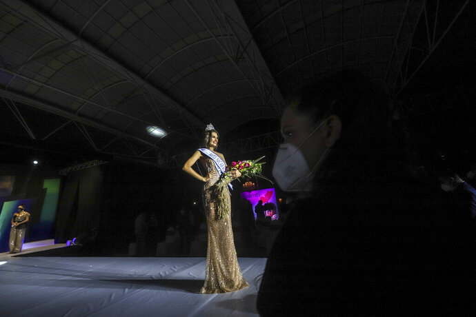 Ana Marcelo, an agroindustrial engineer from the city of Esteli, poses with the crown after being chosen Miss Nicaragua, in Managua, Nicaragua, Saturday, Aug. 8, 2020. Marcelo was crowned in front of a limited audience (two people per contestant spaced safely) plus a production crew of 85. The masks were off the contestants, but the judges wore them and were spaced at a safe distance. (AP Photo/Alfredo Zuniga)