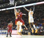 Tennessee's John Fulkerson (10) and Jordan Bowden (23) clamp down defensively against Arkansas's Desi Sills (3) during an NCAA college basketball game, in Knoxville, Tenn., Tuesday, Feb. 11, 2020. (Scott Keller/The Daily Times via AP)