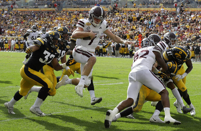 Mississippi State quarterback Nick Fitzgerald (7) scores on a 33-yard touchdown run against Iowa during the second half of the Outback Bowl NCAA college football game Tuesday, Jan. 1, 2019, in Tampa, Fla. (AP Photo/Chris O'Meara)
