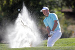 Jordan Spieth blasts from the trap on the eighth hole during the first round of The Players Championship golf tournament Thursday, March 14, 2019, in Ponte Vedra Beach, Fla. (AP Photo/Gerald Herbert)