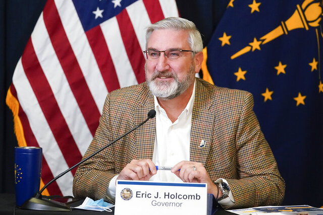 Indiana Gov. Eric Holcomb speaks during a media availability from the Statehouse, Tuesday, Jan. 5, 2021, in Indianapolis.  Holcomb will have a low-key start to his second term on Monday as the coronavirus pandemic that has dominated the past year continues looming over the state. (AP Photo/Darron Cummings)
