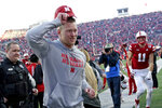 Nebraska head coach Scott Frost tips his cap to spectators as he runs off the field following team's first win of the season in an NCAA college football game against Minnesota in Lincoln, Neb., Saturday, Oct. 20, 2018. (AP Photo/Nati Harnik)
