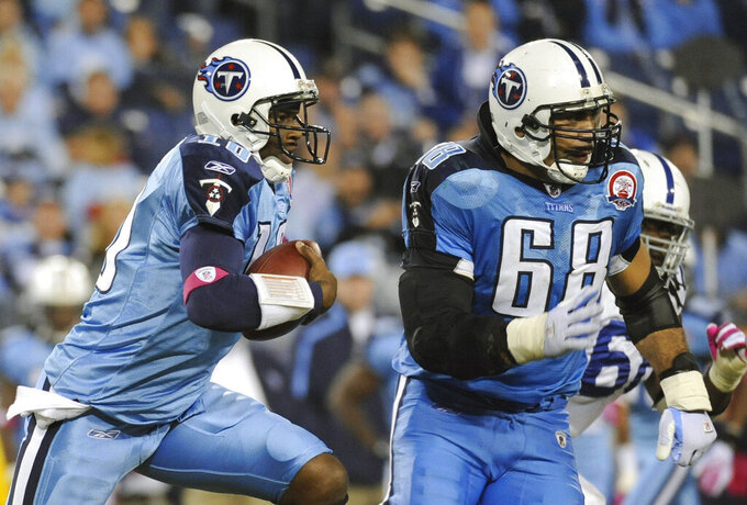 FILE - In this Oct. 11, 2009, file photo, Tennessee Titans quarterback Vince Young (10) scrambles against the Indianapolis Colts as teammate Kevin Mawae (68) blocks in the fourth quarter of an NFL football game in Nashville, Tenn. Mawae will be inducted into the Pro Football Hall of Fame in Canton, Ohio on Aug. 3, 2019. (AP Photo/John Russell, File)