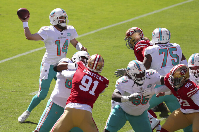 Miami Dolphins quarterback Ryan Fitzpatrick (14) passes against the San Francisco 49ers during the first half of an NFL football game in Santa Clara, Calif., Sunday, Oct. 11, 2020. (AP Photo/Jed Jacobsohn)