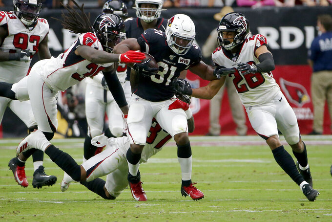 Arizona Cardinals running back David Johnson (31) runs as Atlanta Falcons defensive back Jordan Miller (28) pursues during the first half of an NFL football game, Sunday, Oct. 13, 2019, in Glendale, Ariz. (AP Photo/Rick Scuteri)