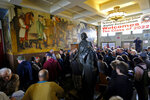 FILE - In this Aug. 1, 2019, file photo, people fill the main entryway of George Washington High School to view the controversial 13-panel, 1,600-square foot mural, the