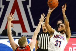 Arizona guard Terrell Brown (31) shoots over Eastern Washington guard Tyler Robertson during the first half of an NCAA college basketball game, Saturday, Dec. 5, 2020, in Tucson, Ariz. (AP Photo/Rick Scuteri)