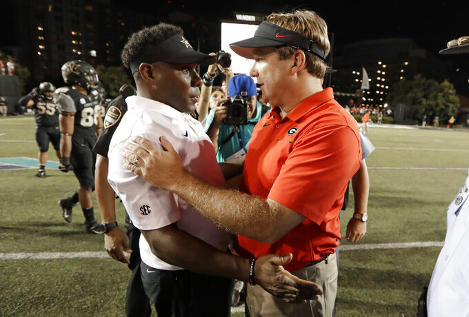 Vanderbilt head coach Derek Mason, left, congratulates Georgia head coach Kirby Smart after an NCAA college football game Saturday, Aug. 31, 2019, in Nashville, Tenn. (AP Photo/Mark Humphrey)
