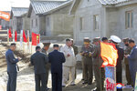 In this undated photo provided on Wednesday, Oct. 14, 2020, by the North Korean government, North Korean leader Kim Jong Un, fifth from left, visits the typhoon-ravaged rural town of Komdok, North Korea, to inspect recovery works. Kim's inspection was his first public activity after weekend celebrations marking his ruling party's founding anniversary. Independent journalists were not given access to cover the event depicted in this image distributed by the North Korean government. The content of this image is as provided and cannot be independently verified. Korean language watermark on image as provided by source reads: