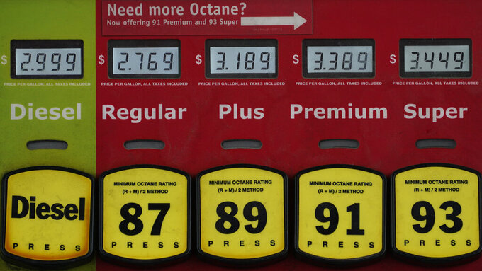 In this March 16, 2021 photo, a gas pump displays gas and diesel prices in Richmond, Va.  Gasoline prices are at a seven-year high, Thursday, May 27,  ahead of one of America's busiest holiday travel weekends. But experts don't expect steep prices to keep eager motorists off the road.     (AP Photo/Steve Helber)