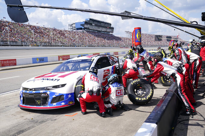 Kyle Larson makes a pitstop during the NASCAR Cup Series auto race at Michigan International Speedway, Sunday, Aug. 22, 2021, in Brooklyn, Mich. (AP Photo/Carlos Osorio)