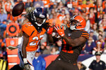 Denver Broncos cornerback Davontae Harris (27) breaks up a pass in the end zone intended for Cleveland Browns wide receiver Antonio Callaway (11) during the first half of NFL football game, Sunday, Nov. 3, 2019, in Denver. (AP Photo/Jack Dempsey)