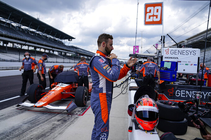 James Hinchcliffe, of Canada, prepares to drive during practice for the Indianapolis 500 auto race at Indianapolis Motor Speedway in Indianapolis, Wednesday, Aug. 12, 2020. (AP Photo/Michael Conroy)