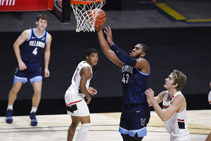Villanova's Eric Dixon shoots as Hartford's Michael Dunne, right, defends during the second half of an NCAA college basketball game Tuesday, Dec. 1, 2020, in Uncasville, Conn. (AP Photo/Jessica Hill)