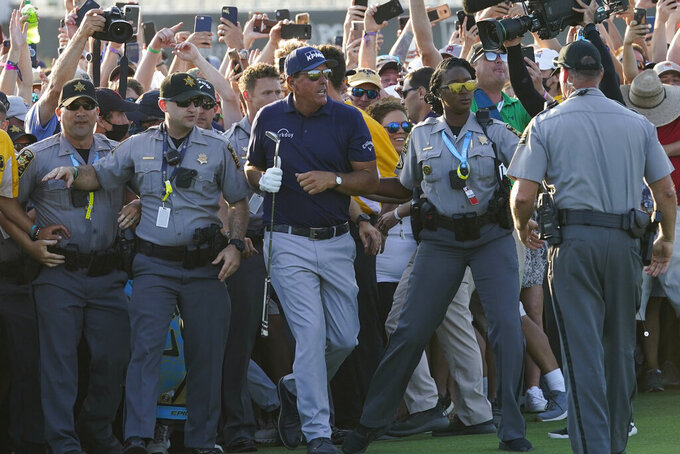Phil Mickelson wades through fans on the 18th fairway during the final round at the PGA Championship golf tournament on the Ocean Course, Sunday, May 23, 2021, in Kiawah Island, S.C. (AP Photo/Matt York)