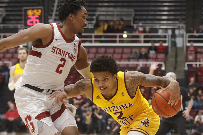 Arizona State guard Rob Edwards, right, drives against Stanford guard Bryce Wills during the first half of an NCAA college basketball game in Stanford, Calif., Thursday, Feb. 13, 2020. (AP Photo/Jeff Chiu)
