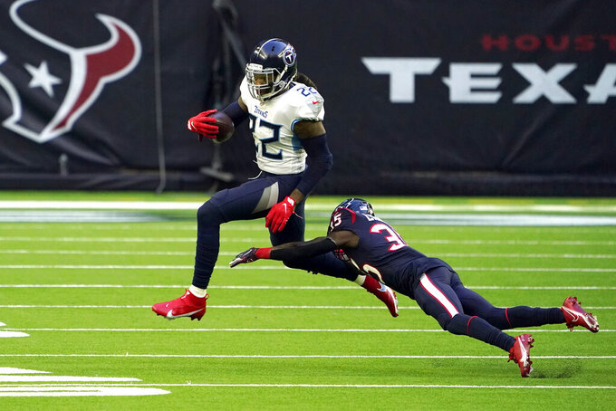 Tennessee Titans running back Derrick Henry (22) avoids Houston Texans cornerback Keion Crossen (35) during the first half of an NFL football game Sunday, Jan. 3, 2021, in Houston. (AP Photo/Eric Christian Smith)