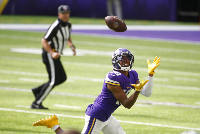 Minnesota Vikings wide receiver Justin Jefferson catches a 71-yard touchdown pass during the second half of an NFL football game against the Tennessee Titans, Sunday, Sept. 27, 2020, in Minneapolis. (AP Photo/Bruce Kluckhohn)
