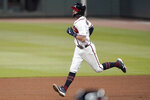 Atlanta Braves shortstop Dansby Swanson rounds the bases after hitting a three-run home run in the fourth inning of a baseball game against the Miami Marlins Wednesday, Sept. 23, 2020, in Atlanta. (AP Photo/John Bazemore)