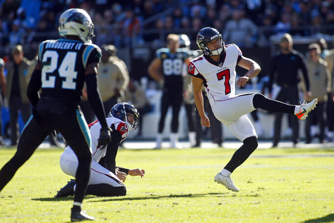 Atlanta Falcons kicker Younghoe Koo (7) watches a field goal during the first half of an NFL football game against the Carolina Panthers in Charlotte, N.C., Sunday, Nov. 17, 2019. (AP Photo/Brian Blanco)
