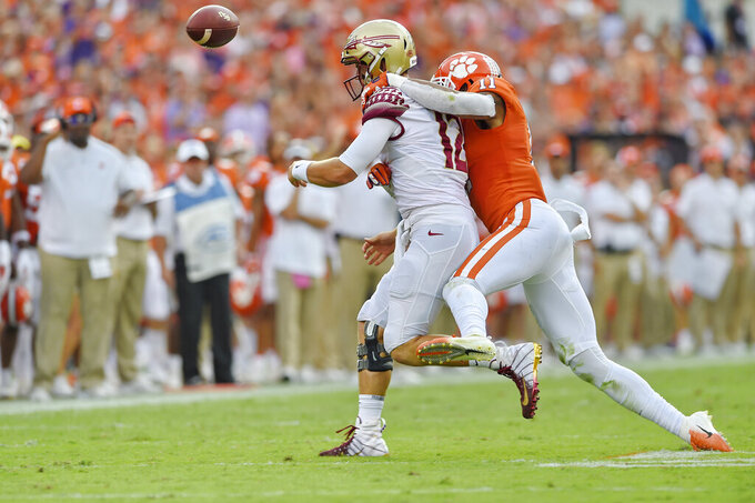 Clemson's Isaiah Simmons tackles Florida State quarterback Alex Hornibrook causing a fumble during the first half of an NCAA college football game Saturday, Oct. 12, 2019, in Clemson, S.C. (AP Photo/Richard Shiro)
