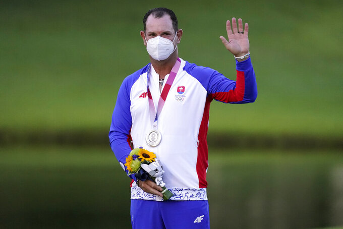 Silver medal winner Rory Sabbatini, of Slovakia, stands on the podium after the men's golf event at the 2020 Summer Olympics, Sunday, Aug. 1, 2021, at the Kasumigaseki Country Club in Kawagoe, Japan, (AP Photo/Matt York)