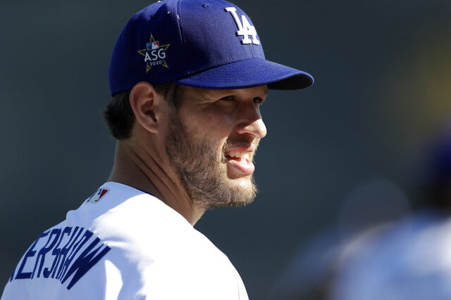 Los Angeles Dodgers pitcher Clayton Kershaw looks on during spring training baseball Wednesday, Feb. 19, 2020, in Phoenix. (AP Photo/Gregory Bull)