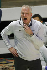 Toledo coach Tod Kowalczyk reacts as Toledo plays Richmond during the second half of an NCAA college basketball game in the first round of the NIT, Wednesday, March 17, 2021, in Denton, Texas. (AP Photo/Ron Jenkins)