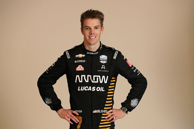 FILE - In this Feb. 10, 2020, file photo, IndyCar driver Oliver Askew poses for photos during IndyCar Media Day  in Austin, Texas. The 2020 season will open Saturday night, June 6, at Texas Motor Speedway in NBC's first ever primetime IndyCar race. The rebranded Arrow McLaren SP team will debut with rookie Oliver Askew, last year's Indy Lights champion, and Pato O'Ward, who has returned to IndyCar after a brief stint last year racing in Europe. (AP Photo/Eric Gay, File)