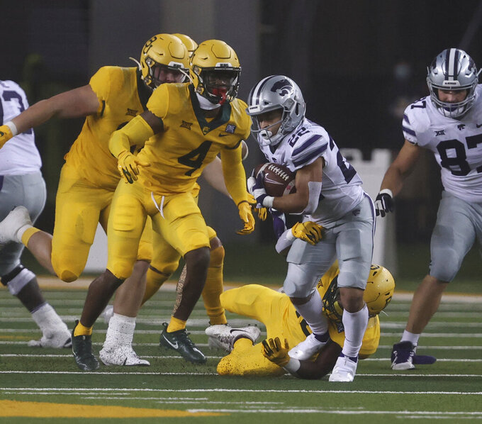 Kansas State running back Deuce Vaughn runs past Baylor safety Christian Morgan, left, in the first half of an NCAA college football game Saturday, Nov. 28, 2020, in Waco, Texas. (Rod Aydelotte/Waco Tribune Herald, via AP)