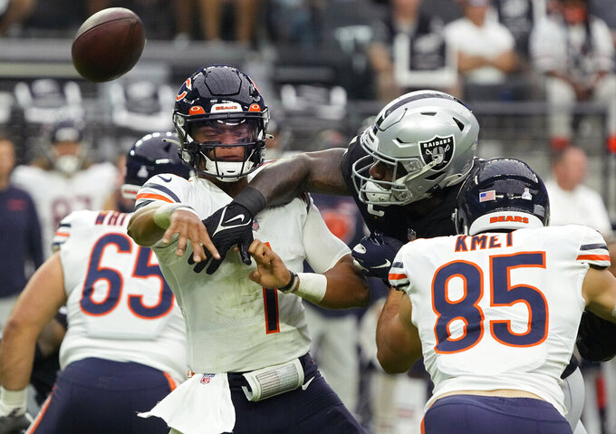 Las Vegas Raiders defensive end Yannick Ngakoue (91) breaks up a pass attempt by Chicago Bears quarterback Justin Fields (1) during the first half of an NFL football game, Sunday, Oct. 10, 2021, in Las Vegas. (AP Photo/Rick Scuteri)
