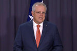 In this image made from video, Australian Prime Minister Scott Morrison speaks during a news conference in Canberra, Australia, Thursday, April 8, 2021. Australia on Thursday become the latest country to restrict use of the AstraZeneca vaccine by recommending that it not be given to people under age 50. (SBS via AP)