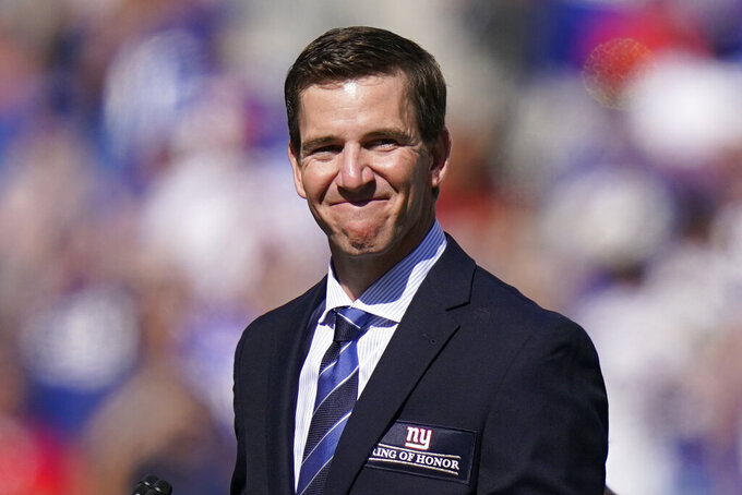 Former New York Giants quarterback Eli Manning smiles as he addresses the crowd during a ceremony to retire his jersey number 10 and honor his tenure with the team during half-time in an NFL football game against the Atlanta Falcons, Sunday, Sept. 26, 2021, in East Rutherford, N.J. (AP Photo/Seth Wenig)