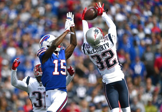 New England Patriots safety Devin McCourty (32) intercepted a pass intended for Buffalo Bills wide receiver John Brown (15) in the first half of an NFL football game, Sunday, Sept. 29, 2019, in Orchard Park, N.Y. (AP Photo/Adrian Kraus)