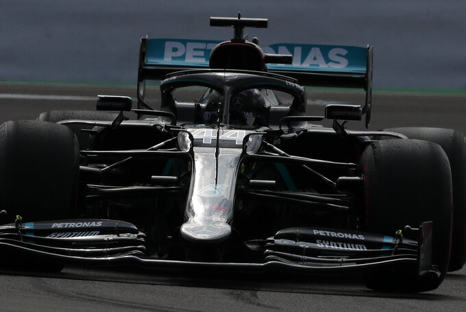 Mercedes driver Lewis Hamilton of Britain steers his car during the second practice session for the British Formula One Grand Prix at the Silverstone racetrack, Silverstone, England, Friday, July 31, 2020. The British Formula One Grand Prix will be held on Sunday. (AP Photo/Frank Augstein, Pool)
