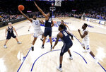 Seton Hall guard Myles Powell (13) goes up for a shot against Georgetown guard Kaleb Johnson (32) during the second half of an NCAA college basketball game in the Big East men's tournament, Thursday, March 14, 2019, in New York. Seton Hall won 73-57. (AP Photo/Julio Cortez)